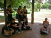 Young people in the park who joined in to listen to Marta\'s experiences with 15-M:
