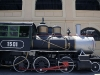 019 Old steam-engine locomotives on exhibit as museum pieces.