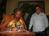 Angolan culture minister signs the Casa de Africa guest book.