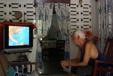 Watching a weather report in Havana.