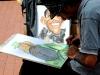 Artist Hugo Chirino drew caricatures of Barack Obama and Fidel Castro