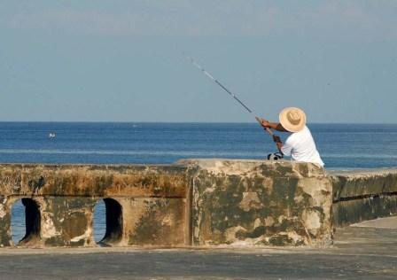 People fish in Cuba but they can't legally sell their excess catch to a willing market.  Photo: Bill Hackwell