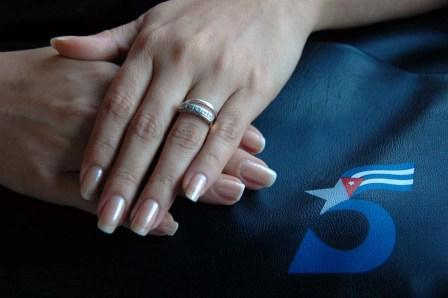 Hands of Adriana Perez, wife of Gerardo Hernandez