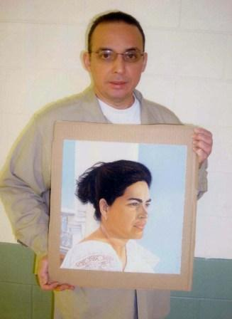 Antonio Guerrero with painting of Adriana Perez wife of Gerardo Hernandez, Florence Federal Prison. The painting belongs to the traveling entitled Bridge of Solidarity