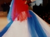 Luz Maria exhibits a wedding gown with the colors of the Cuban flag.