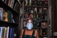 Felicia wearing PPE because of COVID-19 at her second-hand bookstore.