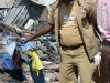 18-while-neighbours-salvage-what-they-can-for-the-injured-owners-a-handful-of-kids-clothes