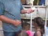 Ricardo Ponce de Leon explaining to the children about planting.