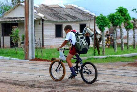 Biking to school in Pinar del Rio.  Photo: Caridad