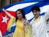 Two passersby with the Cuban flag.
