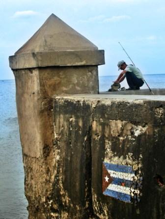 Fishing on the Havana Malecon seawall, photo by Caridad