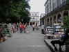 Obispo St. with booksellers.  At the end of the street is the Santa Isabel Hotel.