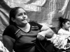 Guatemalan woman waiting to file asylum papers at Immigration on the Mexican side