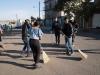 Hondurans sweeping the street