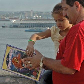 Reading over Havana Bay, photo by Caridad