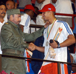 Fidel Castro congratulates Yulieski Gourriel after the first World Baseball Classic in 2006 when Cuba finished second to Japan