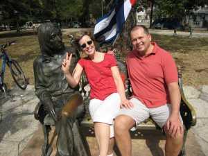 Ottawa Mayor Robert Eschbach and his sister pose next to the John Lennon Statue in Havana