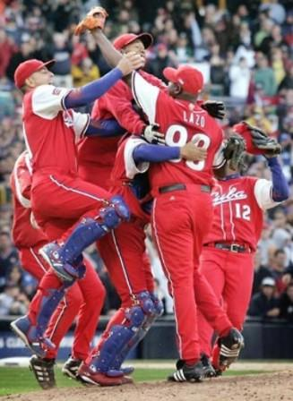Cuban team celebrating a big win in the first World Baseball Classic