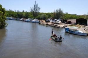 The Cojimar River, still calm, hopes its romantic little boat will return some day.