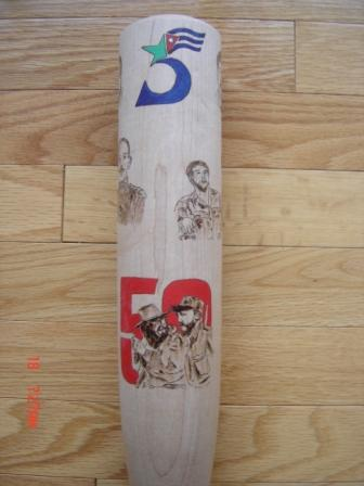 Bat made by Bill Ryan to celebrate the Cuban Revolution's 50th anniversary and in support of the Cuban Five.