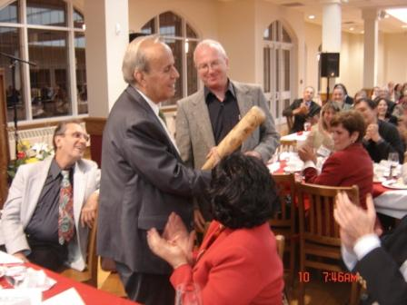 Bill Ryan presents his special maple wood bat to Ricardo Alarcon, president of the Cuban parliament.