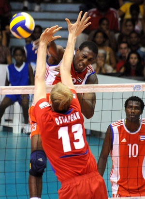 Cuba is tied for first place spirited by the center net play of Robertlandy Simon, the team captain. Photo: www.jit.cu