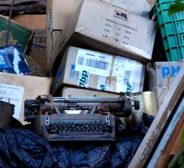 An Underwood typewriter in the trash.