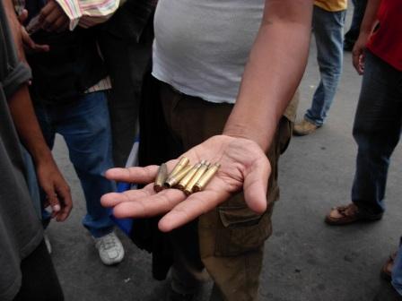 Honduran soldiers used tear gas and live ammo to disperse protestors demanding the return of President Manuel Zelaya. Photo: Luis Miranda