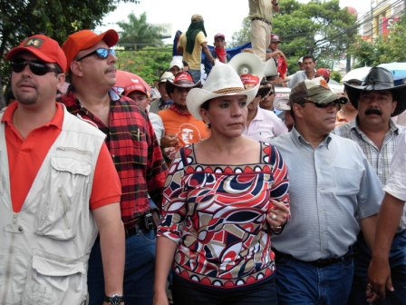 The president's wife, Xiomara Castro de Zelaya, center, came out of hiding to head Tuesday's march.