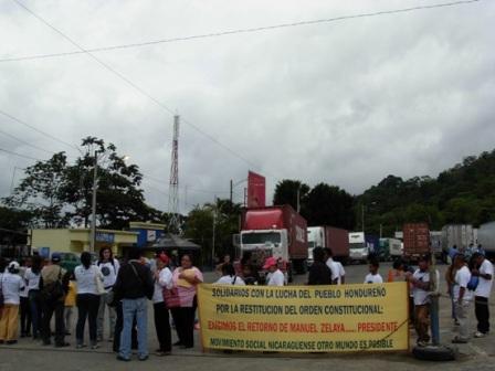 We demand the return of President Manuel Zelaya
