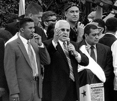 Roberto Micheletti, center, the defiant de-facto president of Honduras.