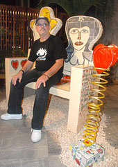 """Fuster sitting on his """"bench of love"""""""