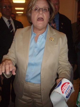 Rep. Ileana Ros-Lehtinen hurls accusations Thursday against those opposing the travel ban while holding her enemies' stickers in her hand.