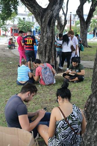 Using the pay-for Wi-Fi in Monaco Park, Havana. Photo: Juan Suarez