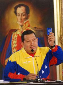 President Hugo Chavez holding up the Venezuelan constitution. Photo: Caridad