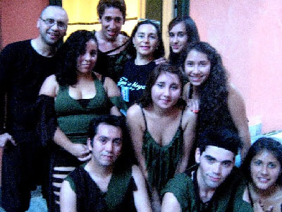 The entire dance company, with director Cyntia Moya at the center.