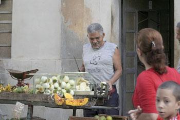 Havana street vendor selling oranges and squash.