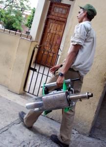 Fumigation campaign worker.  Photo: Caridad
