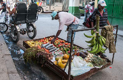 Food sold by black market dealers placed a few centimeters away from sewage. (Photo: Raquel Perez)