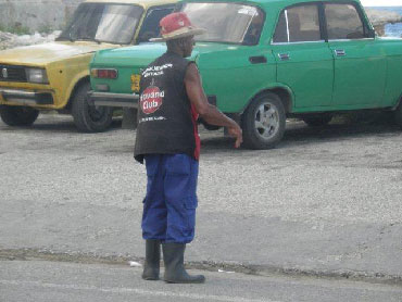 Feliz at his afternoon job as a parking  attendant.