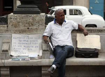 "Real Estate activity becomes a legal activity in Cuba. The photo is of a ""runner"" on Havana's Prado promenade."
