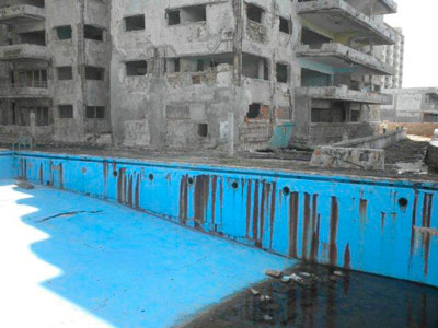Swimming pool and part of the building.