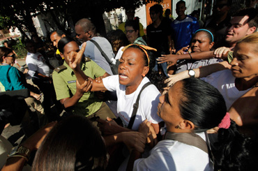 Cuban dissidents being detained on Human Rights Day. Photo: www.aljazeera.com