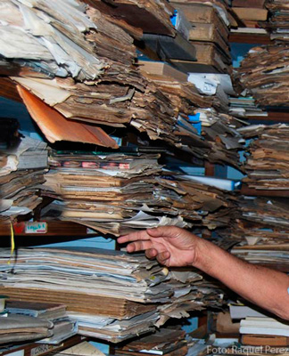 The computerization of society has yet to arrive. Most public documents are still paper files.