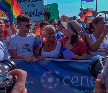 Adela at a gay pride parade in Cuba next to Mariela Castro, daughter of Cuba's president and head of the country's Sexual Education Center (CENESEX)