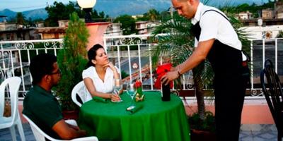 Porch table at the Salon Tropical restaurant in Santiago de Cuba.