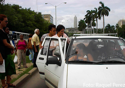 Public transportation shortages continues to force many Cubans to hitchhike around the city.