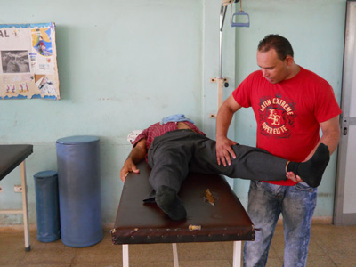 At the gym, physical therapists help you do the exercises prescribed by the doctor.