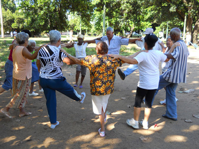 Elderly improve their conditions with outdoor exercise in front of the rehabilitation center.
