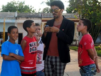 Actor Jazz Vila with local kids.
